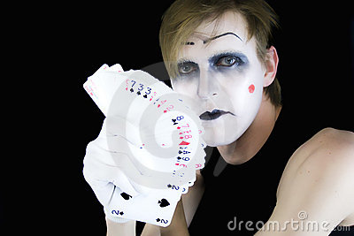 Mime with a fan of playing cards