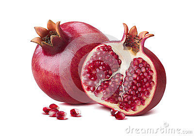 Whole pomegranate half seeds isolated on white
