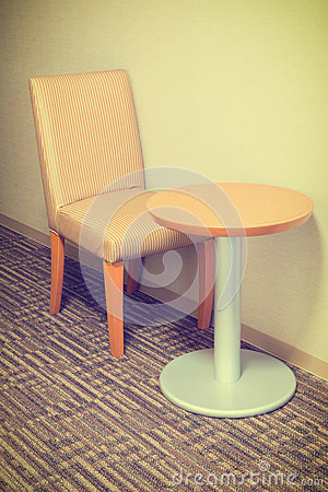 Modern sofa chair and table in hotel room