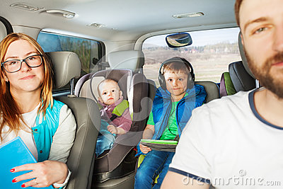 Happy family having fun travelling by car
