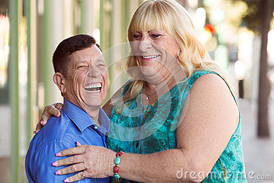 Laughing transgender couple outside