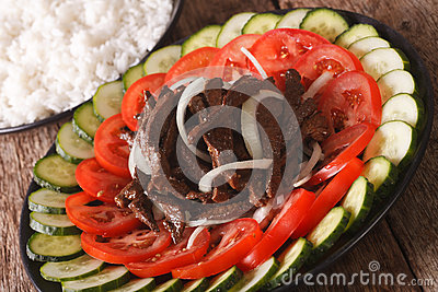 Cambodian beef Lok Lak with fresh vegetables and a side dish of