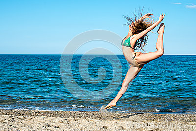 Girl blonde on the beach try a dancer