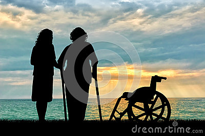 Silhouette of a disabled wheelchair near peepers and near sea. Concept of a disabled person and home for elderly