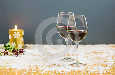 New year's eve cheers with two glasses of red wine and grapes