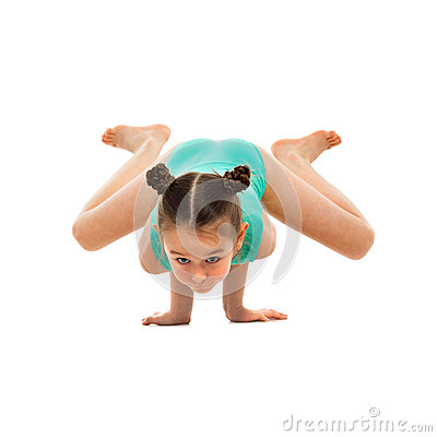 Flexible little girl gymnast doing acrobatic feat on white background