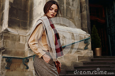 Fashion Clothes. Beautiful Woman In Fashionable Clothing Outdoor