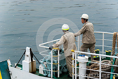 Japanese ferry workers waiting to dock