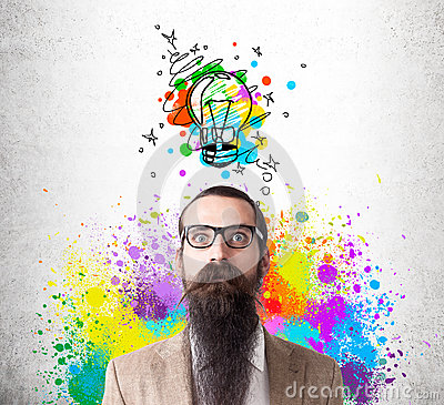Baffled man in rainbow with colorful light bulb