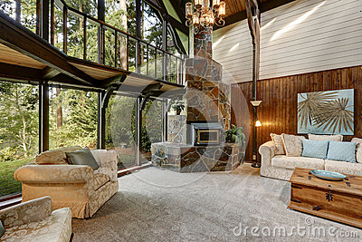 Modern wooden cottage house interior with living room close up