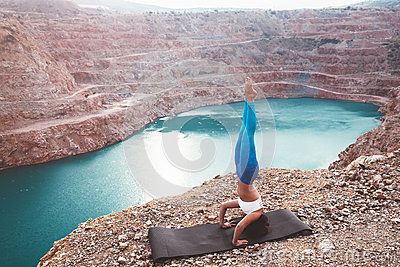 Girl training yoga pose outdoor