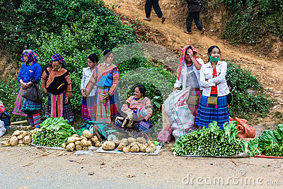 Lao cai tribal selling vegetable at market