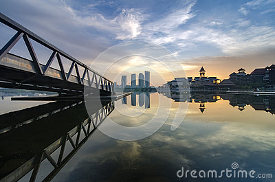 Stunning morning view near the lakeside, modern building and wooden jetty