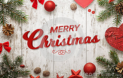 Merry Christmas text on white wooden surface. Christmas tree