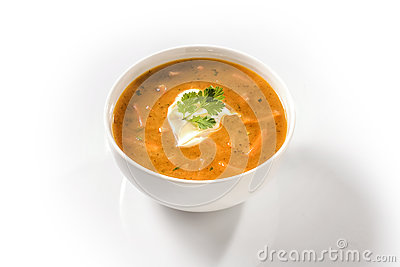 Cream Carrot Soup Garnished with Sour Cream
