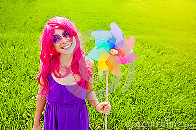 Optimistic young woman wearing pink wig