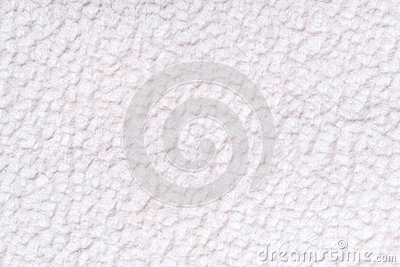 White fluffy background of soft, fleecy cloth. Texture of textile closeup.
