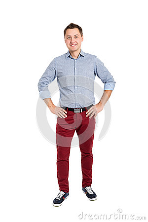 Full length portrait of happy handsome young man