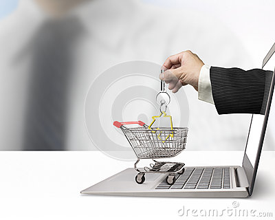 Hand from laptop screen taking house key in shopping cart