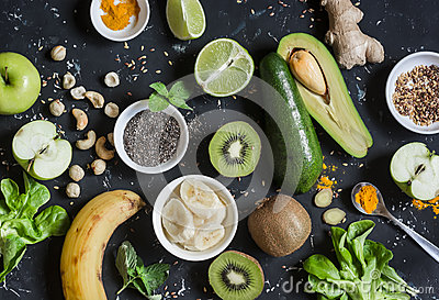 Green smoothie ingredients. Cooking healthy detox smoothies. On a dark background