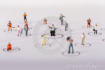 The concept of a collective solution to any problem. Miniature toy workers.
