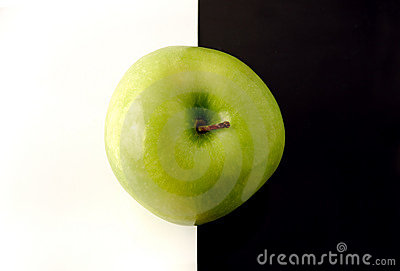 Granny Smith apple on artistic background