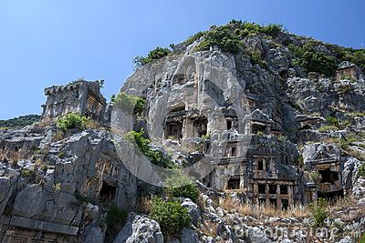 A cliff face covered in Lycian rock-cut tombs at the ancient site of Myra at Demre in Turkey.
