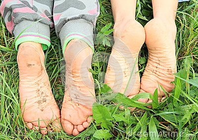 Dirty soles of bare feet