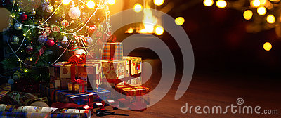 Art Christmas tree and holidays present on fireplace background