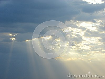 Descent of Divine Blessings from Sky - Sun Rays through Clouds
