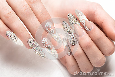 Beautifil wedding manicure for the bride in gentle tones with rhinestone. Nail Design. Close-up