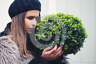 Cute Woman Embracing Green Plant Tree. Environmental Concept
