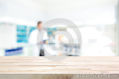 Empty wood counter top on blur pharmacy background