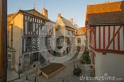 Square with half-timbered houses, in the medieval village Noyers