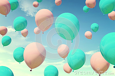 Colorful blue and pink balloons floating in summer holidays in pastel color filter, concept of summer, holidays, and joyful