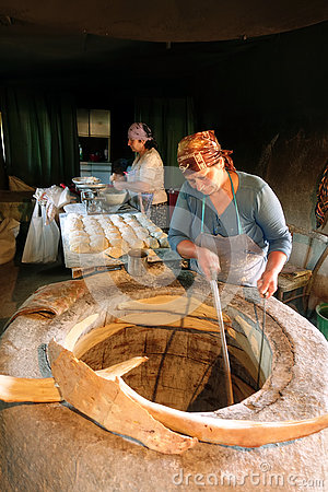 Woman baking traditional Georgian bread