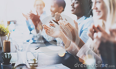 Photo of partners clapping hands after business seminar. Professional education, work meeting, presentation or coaching