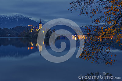 Bled lake and pilgrimage church at twilight reflected in water