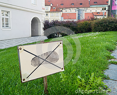 Sign: don`t walk on the grass. Prohibitions in our lives
