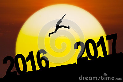 Young man jumping with number 2016 and 2017