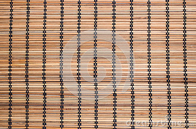 Brown background with thin strips of bamboo tree