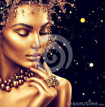 Beauty fashion model girl with golden skin, makeup and hairstyle
