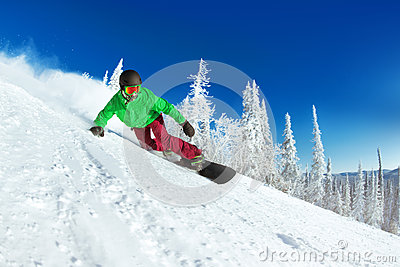 Active snowboarder snowboarding rides closeup
