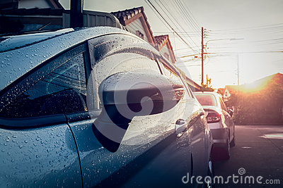 Car is wet with dew in the morning