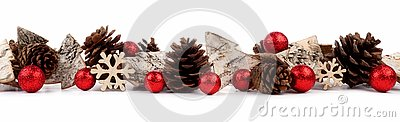 Christmas border with rustic wood tree ornaments, baubles and pine cones isolated over white
