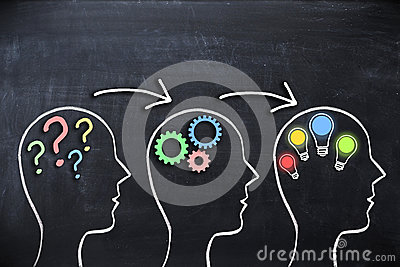 Coaching concept – knowledge and ideas sharing with human head shape and megaphone or bullhorn on blackboard