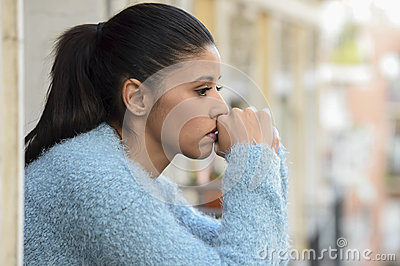 Beautiful sad and desperate hispanic woman suffering depression thoughtful frustrated