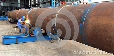 Welding person weld oil and gas offshore industry big pipe work