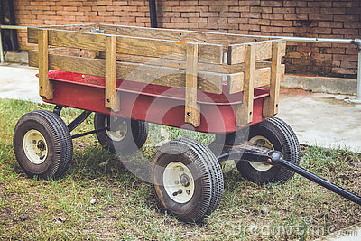 Red cart with wood panel for argriculture