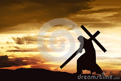 Silhouette of Jesus carry his cross